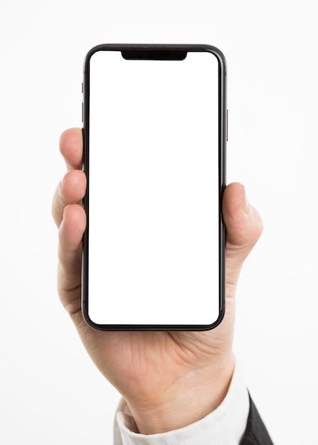 Mão segurando smartphone Foto gratuita