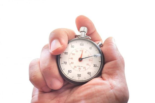 Mão segurando um cronômetro isolado no branco Foto Premium