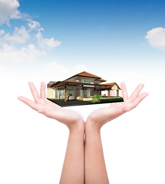 Mãos com uma casa de luxo Foto gratuita