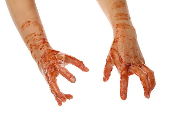 Mãos de zumbi de sangue isoladas no branco Foto Premium