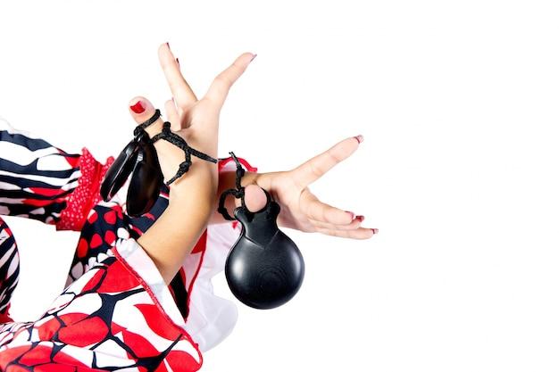 Mãos detalhe da dançarina de flamenco com lindo vestido Foto gratuita