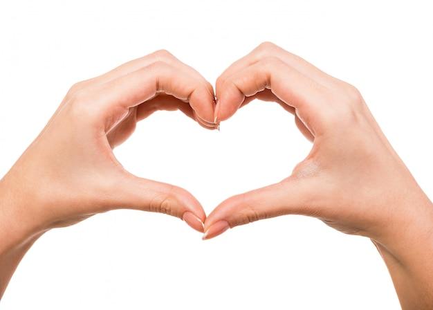 Mãos femininas em forma de coração em branco Foto Premium