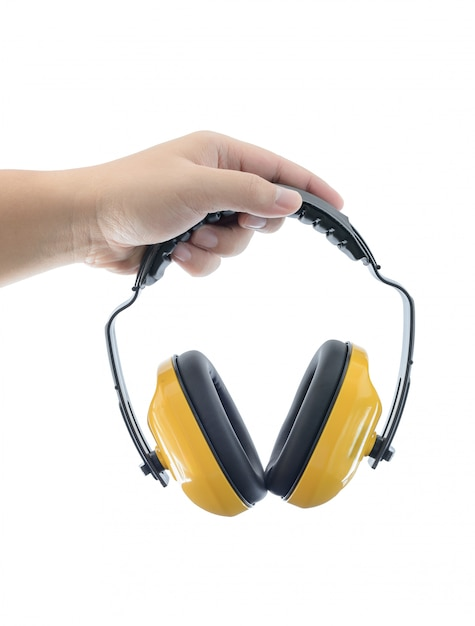 Mãos mantém trabalhando protetora fones de ouvido é isolado Foto Premium