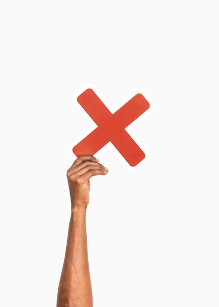 Mãos, segurando, multiplique, símbolo Foto gratuita