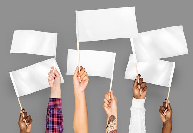 Mãos, waving, branca, vazio, bandeiras Foto gratuita