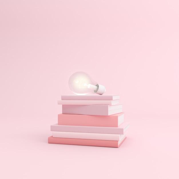 Maquete de livro empilhado e lâmpada Foto Premium