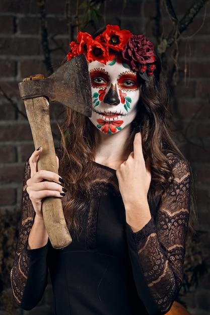 Maquiagem de caveira de açúcar feminino. arte de pintura de rosto. Foto Premium