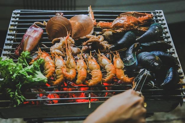Marisco grelhado, comida de rua Foto Premium