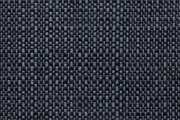 Matéria têxtil dos azuis marinhos com teste padrão quadriculado, close up. estrutura da macro de tecido. Foto Premium