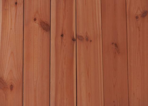 Materiais de construção modernos e ecológicos - fundo de tábuas de assoalho de pinho coloridas com óleo Foto Premium