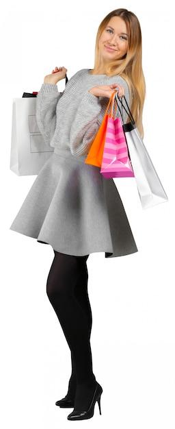 Menina, com, bolsas para compras, branco, fundo Foto Premium