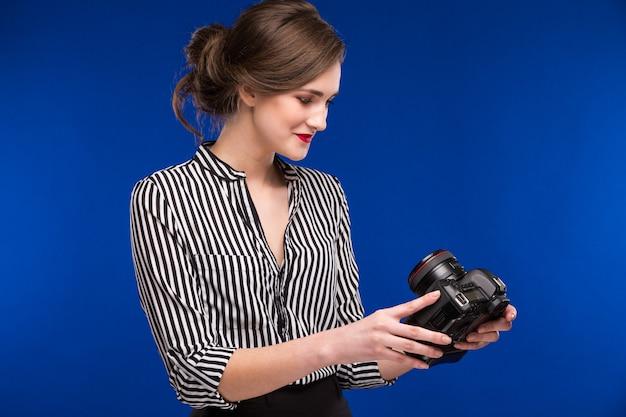 Menina com câmera Foto Premium