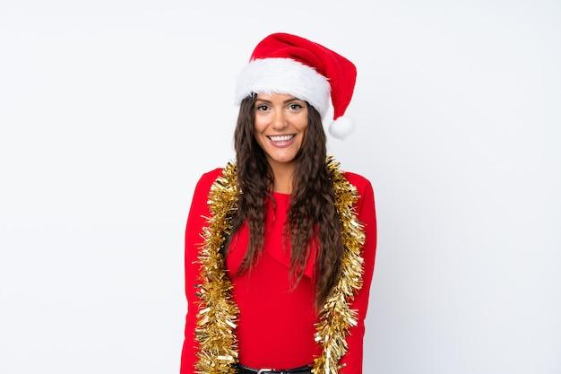 Menina com chapéu de natal sobre fundo branco isolado Foto Premium
