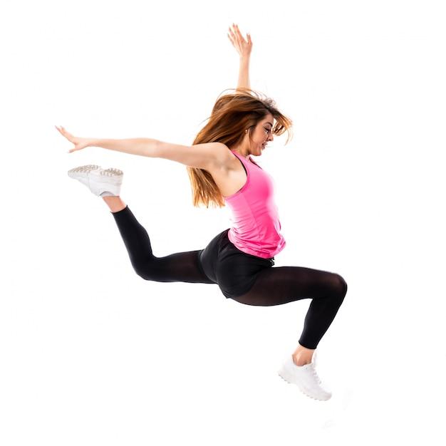 Menina de dança jovem sobre salto branco isolado Foto Premium