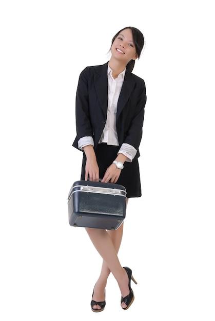 Menina de negócios sorridente com caixa de ferramentas, retrato de corpo inteiro em fundo branco. Foto Premium