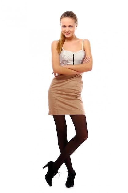 Menina jovem e bonita no branco Foto gratuita