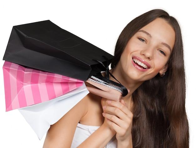 Menina sorridente, com, bolsas para compras Foto Premium