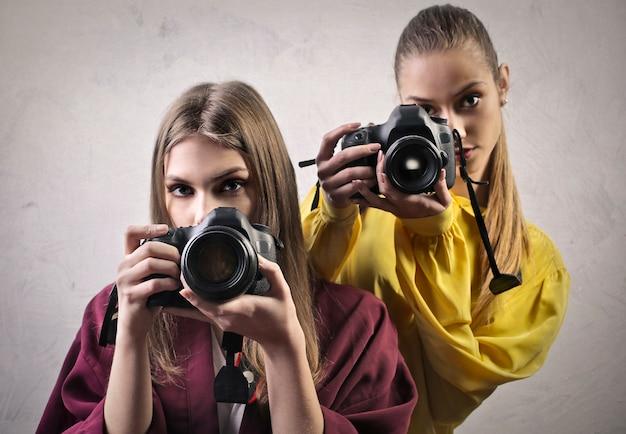 Meninas bonitas com câmeras Foto Premium
