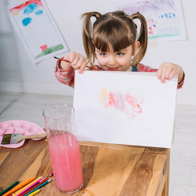 Menininha, mostrando, quadro, ligado, papel Foto gratuita