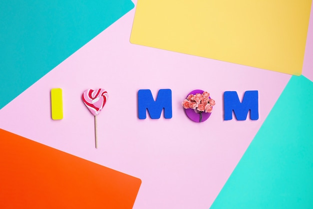 Mensagem do dia das mães na cor de fundo. vista do topo Foto Premium