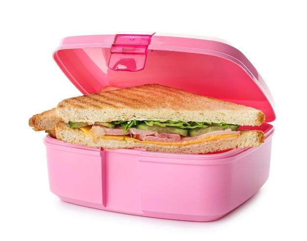 Merendeira escolar com comida saborosa em branco Foto Premium
