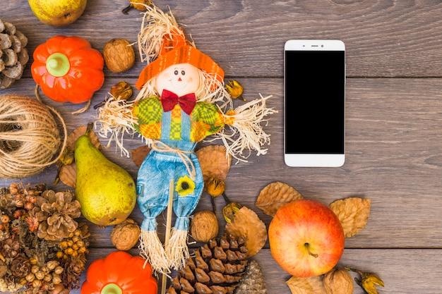 Mesa coberta com legumes e smartphone Foto gratuita