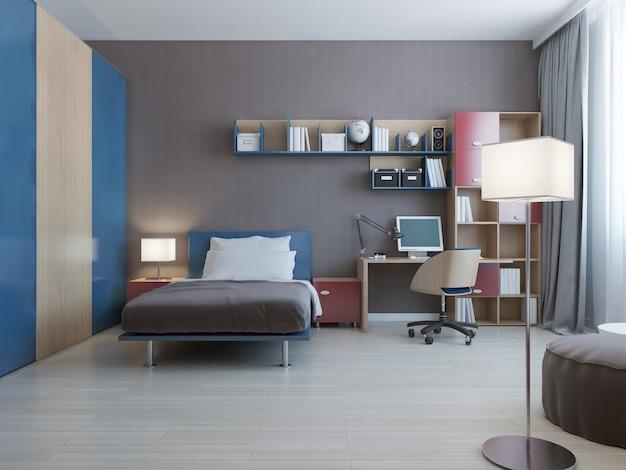 Mesa com sistema de parede em quarto moderno com sistema de parede nas cores azul e vermelho e cama forrada com travesseiros e grande armário com portas de correr azuis. Foto Premium