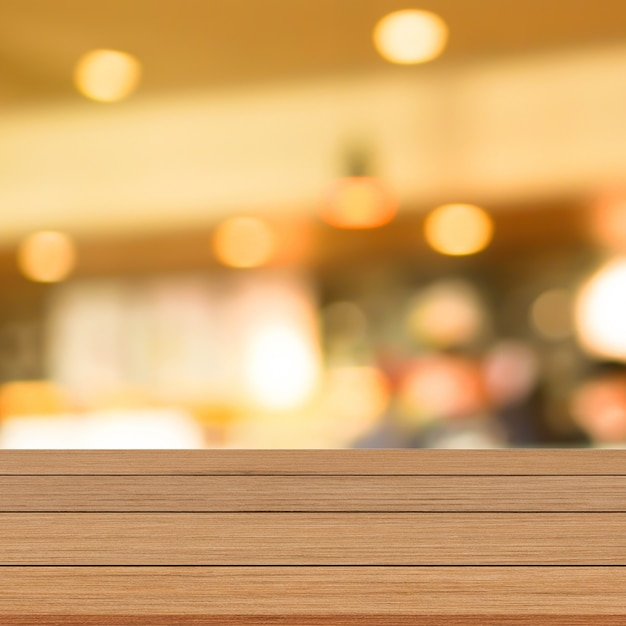 Mesa de madeira marrom moderna com fundo desfocado restaurante Foto Premium