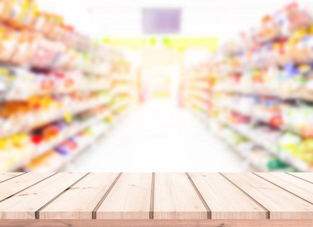 Mesa de madeira ou piso de madeira com supermercado desfocar o fundo para a exposição do produto Foto Premium