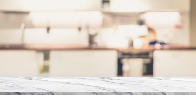 Mesa de mármore branca vazia vista superior com cozinha em casa turva Foto Premium