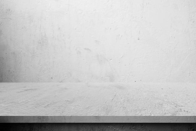 Mesa de prateleira de cimento e fundos de parede, para produtos de exibição Foto Premium