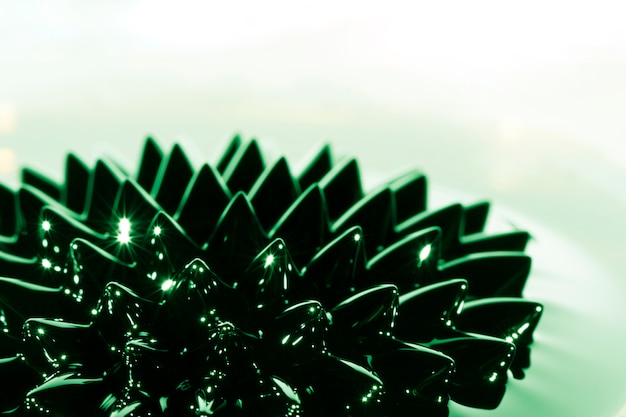 Metal ferromagnético close-up com substância verde Foto gratuita