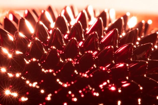 Metal ferromagnético close-up com tons de vermelho e laranja Foto gratuita
