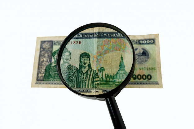 Mil conta de kios do laos e uma lupa Foto Premium