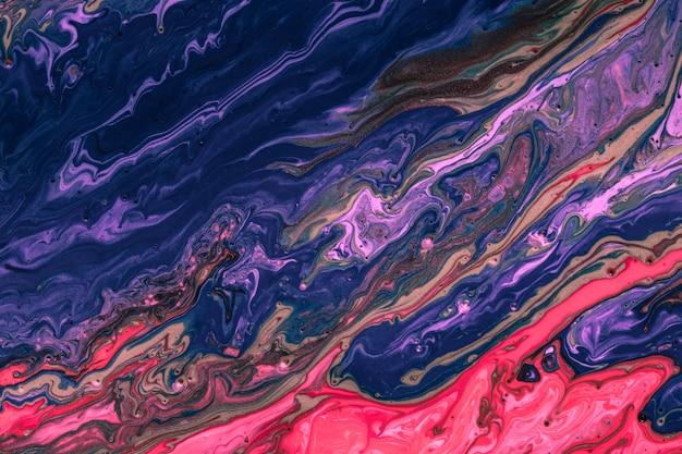 Mistura azul e vermelha colorida de cores vibrantes acrílicas Foto gratuita