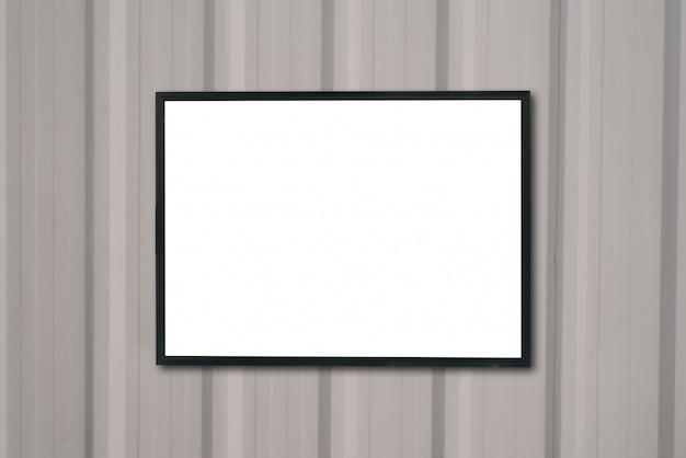 Mock-se moldura de cartaz em branco na parede de madeira. Foto Premium