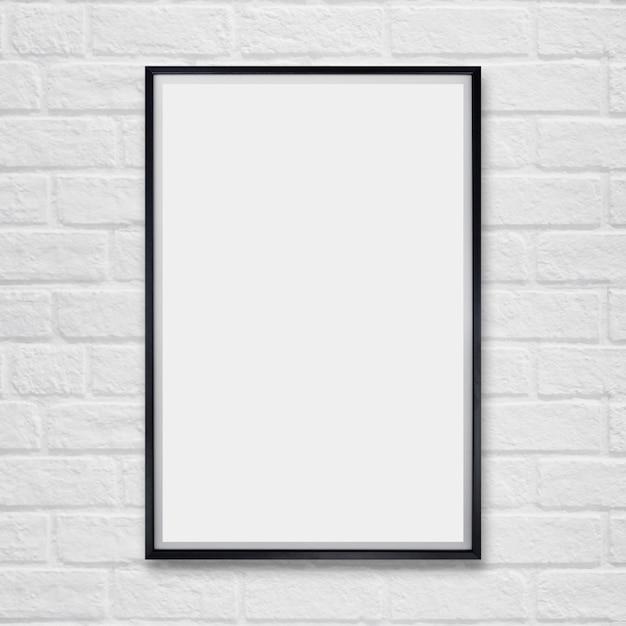 Mock-se moldura de cartaz em branco na parede de tijolos. Foto Premium
