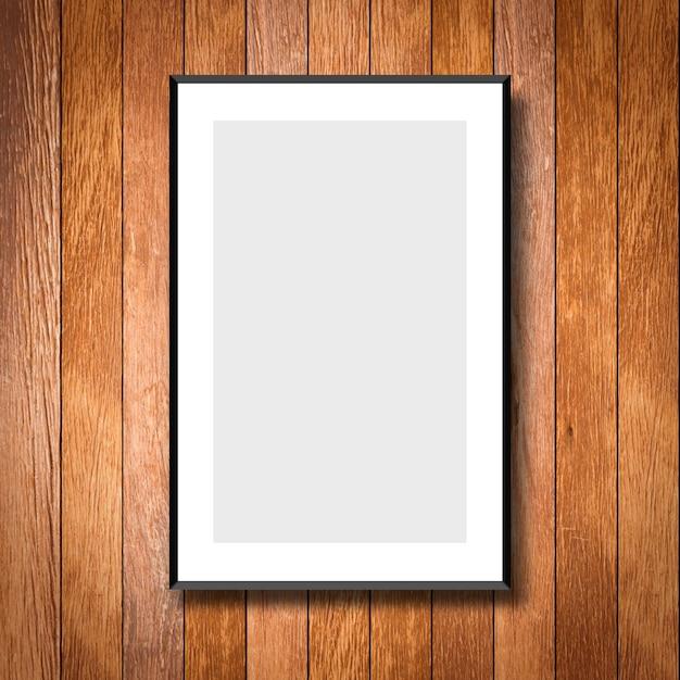Mock-se quadro poster branco no fundo da parede de madeira de creme Foto Premium