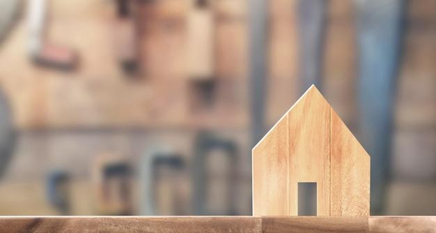 Modelo de casa de madeira no espaço lá de madeira. casa, conceito de imóveis de habitação Foto Premium