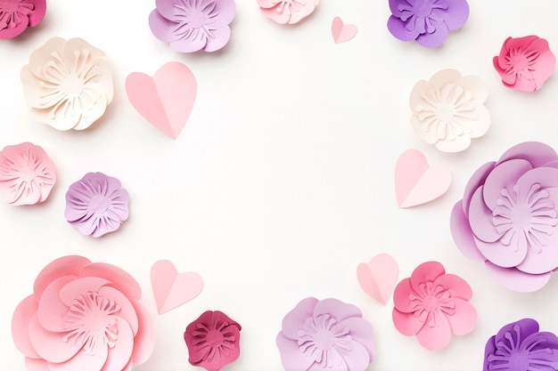 Moldura de vista superior do ornamento de papel floral Foto gratuita
