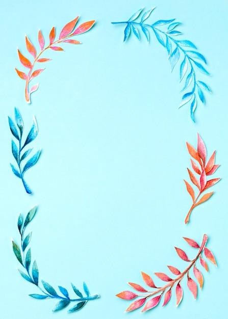 Moldura de vista superior feita de folhas tropicais Foto gratuita