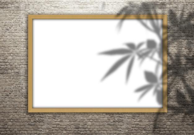 Moldura em branco 3d em uma parede de tijolos com sobreposição de sombra de folhas Foto gratuita