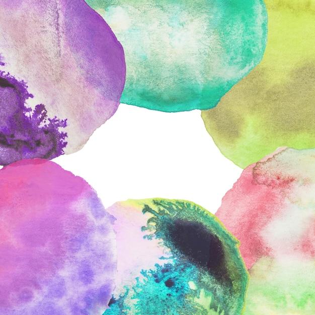 Moldura feita com pano de fundo colorido aquarela Foto gratuita