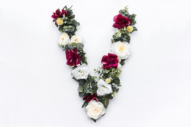 Monograma floral da flor letra v Foto gratuita
