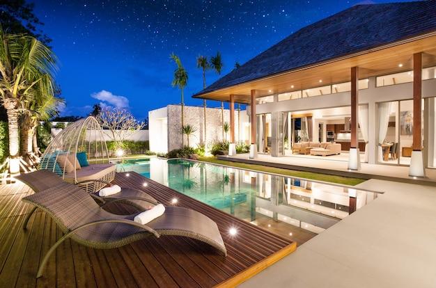 Moradia com piscina de luxo e design exterior com sala de estar Foto Premium