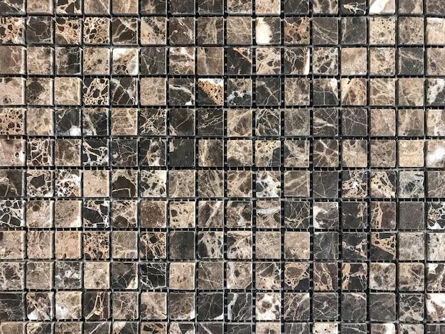 Mosaico de azulejos de pedra cinza para decoração do banheiro e piscina. Foto Premium