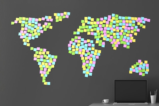 Muitos adesivos colados em uma parede cinza escura na forma de um mapa do mundo Foto Premium