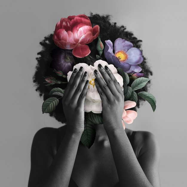 Mulher afro-americana com flores postagem na mídia social do movimento blm Foto gratuita