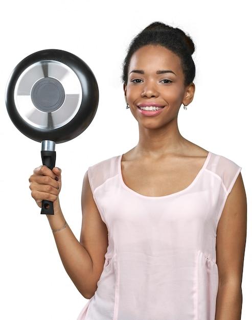 Mulher americana africana, segurando, utensílios cozinha Foto Premium