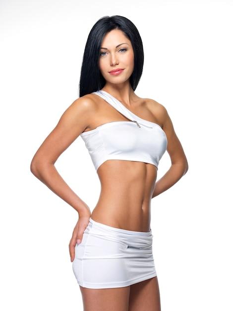 Mulher bonita com corpo esguio e esportivo Foto gratuita